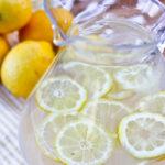 Lavender Lemonade- Quick, Easy, and Perfect for Parties. Only ingredients needed- lavender petals, sugar, + lemons. Optional: Add gin or vodka for Hard Lavender Lemonade!