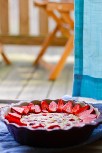 This easy Strawberry Raspberry Clafoutis is a light and delicious French cobbler, and the perfect way to show off your spring and summer berries! champagne-tastes.com