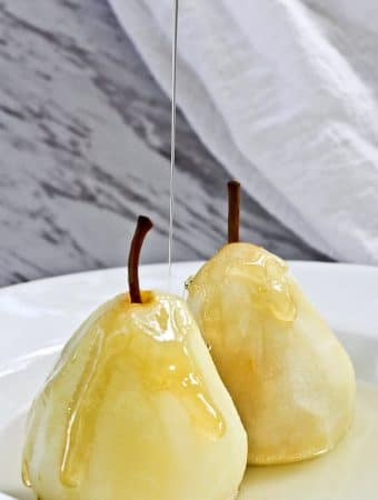 These Poached Pears with Cardamom are a light and delicious dessert of pears poached in a spiced white wine.