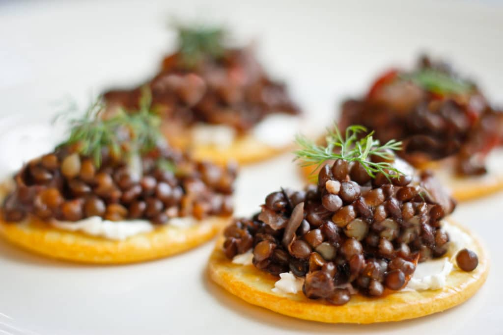 These vegan-friendly Beluga Lentil Caviar feature black beluga lentil salad served on top of crackers and cream cheese, and are the perfect cold weather appetizer for your dinner party!