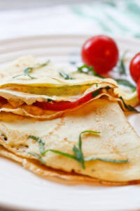 These savory, vegetarian Tomato and Herbed Cheese Crepes are quick, delicious, and easy to prepare
