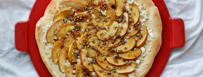 This vegetarian Savory Apple Pizza is gourmet pizza at its most delicious. It's made with sauteed apples over mozzarella and gorgonzola cheeses, and is topped with fig syrup and pecans.