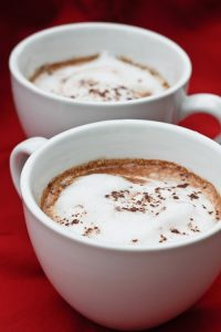 Starbucks Copycat! This vegan-friendly spicy Chile Mocha is made with freshly brewed espresso, steamed milk (or coconut milk), and spicy hot cocoa. champagne-tastes.com