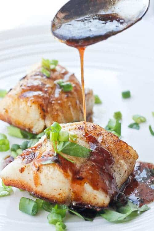 This Kentucky Bourbon Seared Cod features flaky white cod topped with a sweet bourbon sauce. It's perfect for date night or Derby Day! Best of all-- it's ready in about 15 minutes!