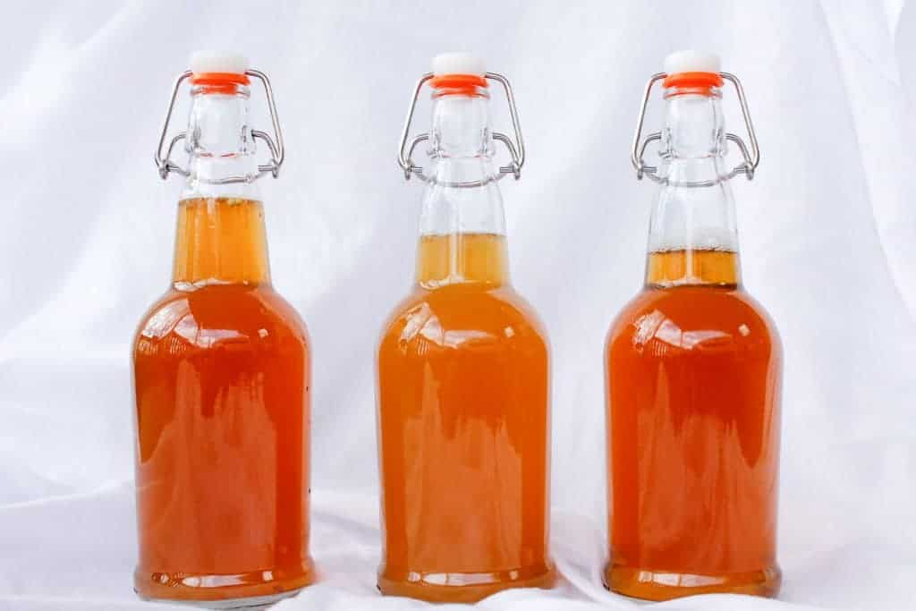 Are you tired of buying store-bought kombucha? This tutorial will walk you through How to Make Kombucha-- all the way from the scoby to the bottling!