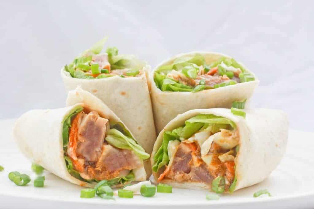 TheseWasabi Ahi Tuna Burritos are made with delicious, high-quality ahi tuna, filled with crunchy veggies, and drizzled with a ginger soy sauce and a spicy yogurt