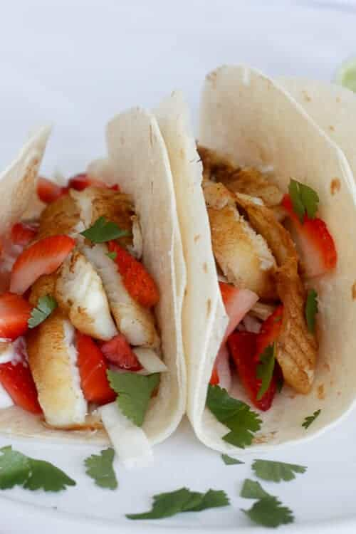 These Strawberry Rhubarb Tilapia Tacos are filled with a strawberry cole slaw, sweetened rhubarb, and ginger seared tilapia.