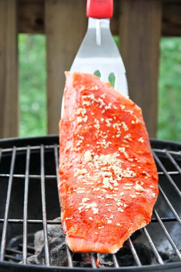 This Grilled Chili Ginger Salmon with Strawberry Salsa is sweet, savory, and spicy! Make this grilled salmon the centerpiece at your next cookout!