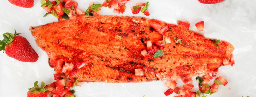 This Grilled Chili Ginger Salmon with Strawberry Salsa is sweet, savory, and spicy! Make this grilled salmon the centerpiece at your next cookout! champagne-tastes.com