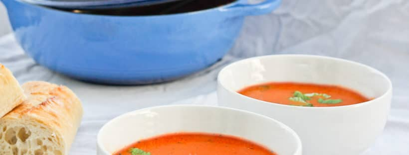 This Indian Spiced Tomato Soup is a flavorful twist on the classic American soup is made with warming spices, tomatoes, and fresh herbs. Champagne Tastes - champagne-tastes.com