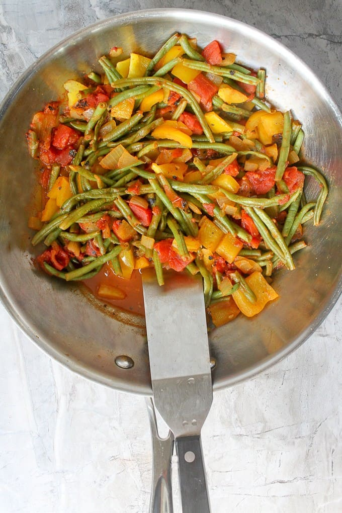 Add the veggies to the spiced tomato mixture