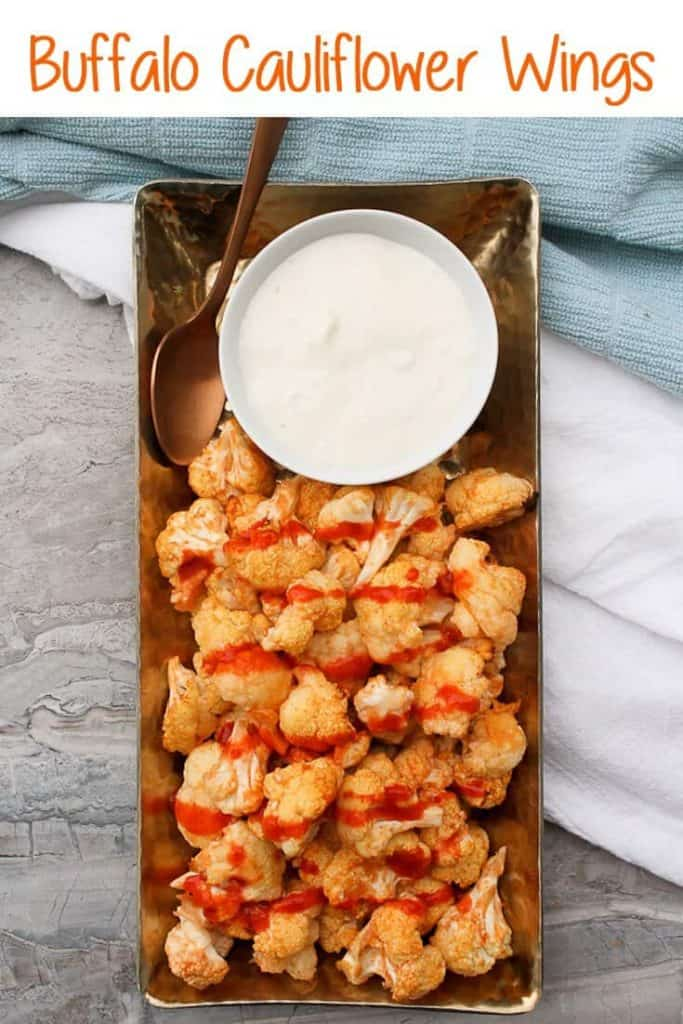 These vegan-friendly Buffalo Cauliflower Wings are baked until crispy, and are perfect for Game Day as an easy and healthy appetizer!
