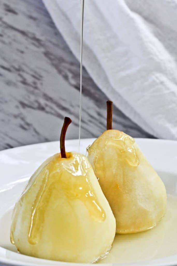 Pouring Honey on Poached Pears with Cardamom