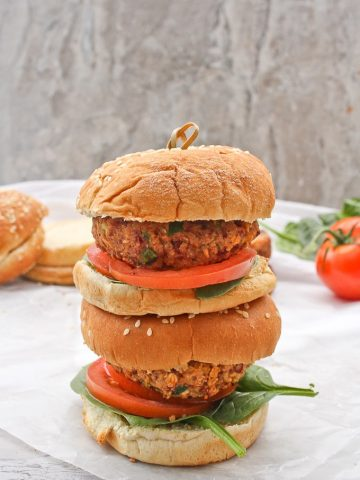 These Vegan Quinoa Burgers are packed with quinoa, beans, and oats for an incredibly quick and delicious take on homemade veggie burgers!