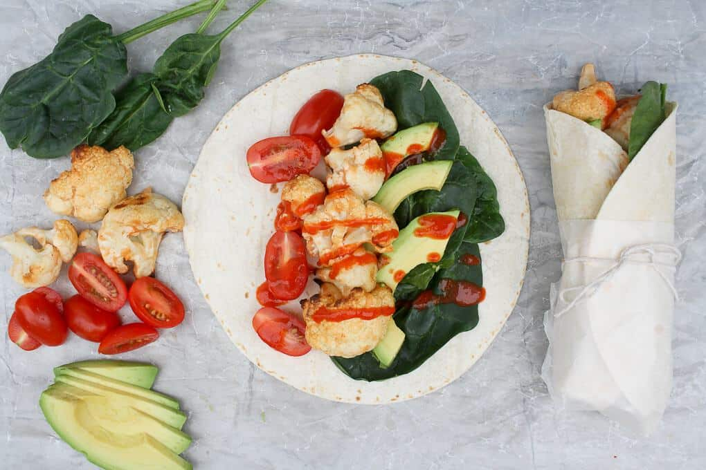 Buffalo Cauliflower Veggie Wraps with ingredients