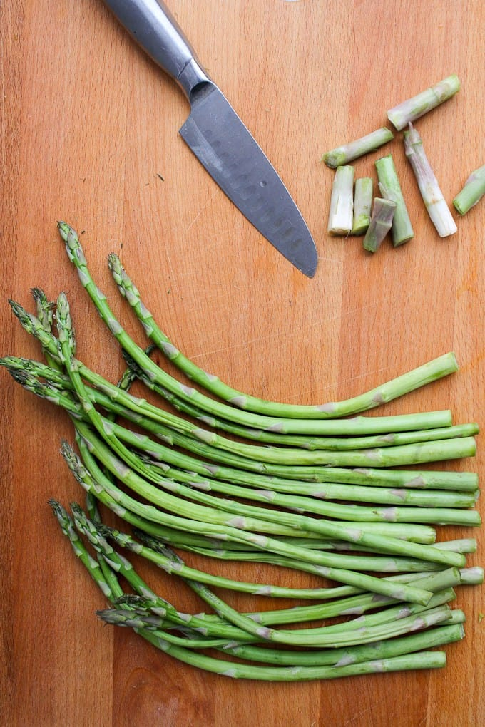 Cutting the Woody ends off the asparagus