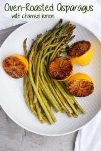 This Oven-Roasted Asparagus with Charred Lemon is drizzled in olive oil, golden balsamic vinegar, lemon slices, and seasoning. It's fast, easy, and delicious!