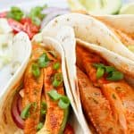 These Grilled Spicy Fish Tacos are marinated in a lime juice and chili powder, and grilled to perfection.