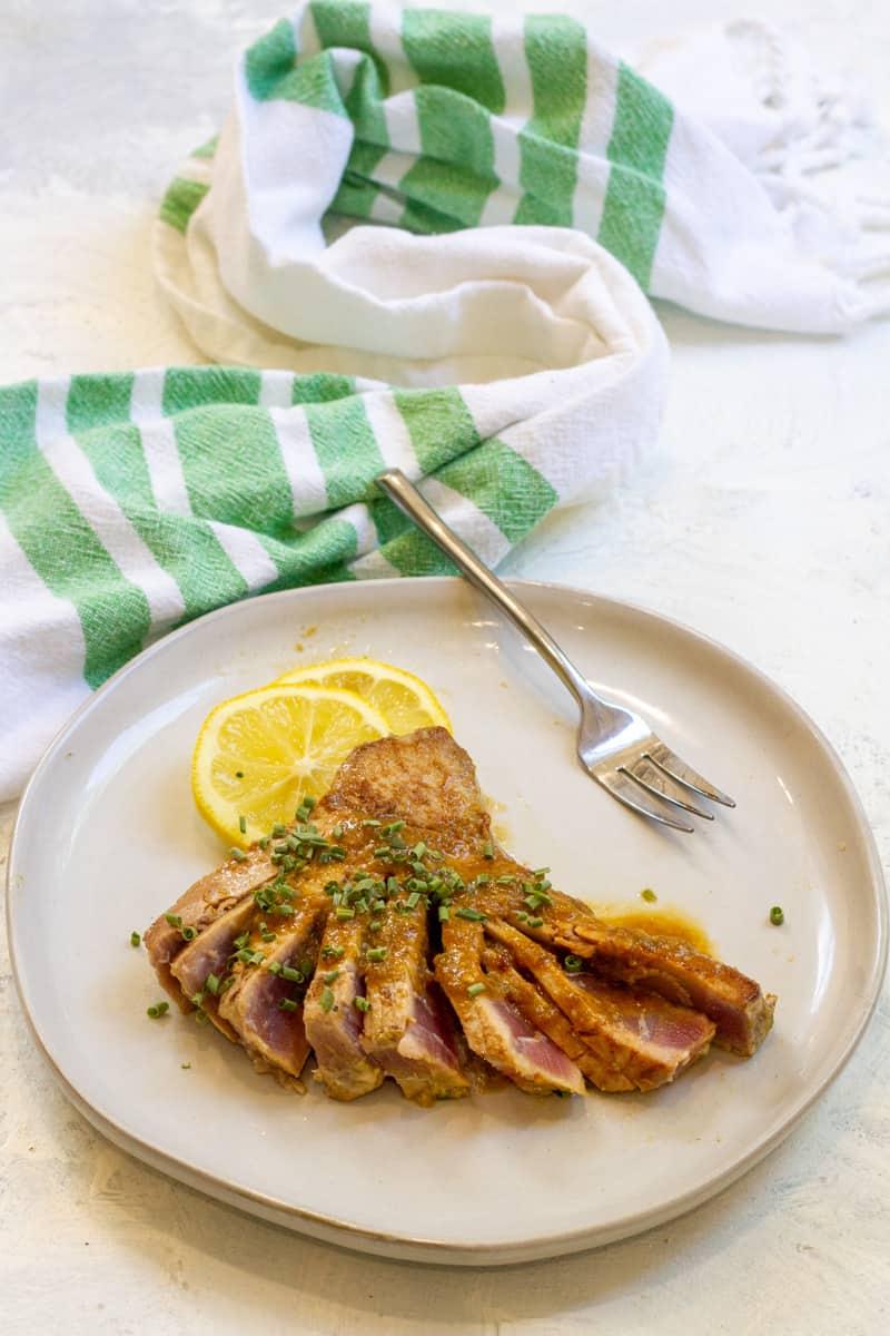 ahi tuna steaks on a plate