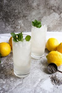 lavender lemonade in glasses with mint