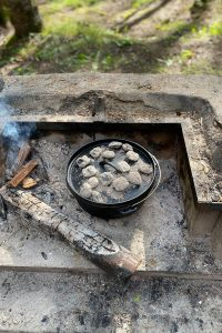 Place Dutch Oven on Coals + Top with More Coals.