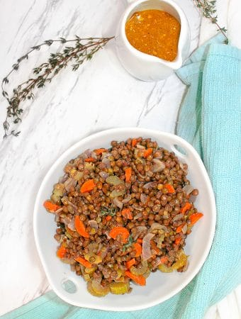 French Lentil Salad in a bowl with Dijon onFrench Lentils with Dijon Vinaigrette the side