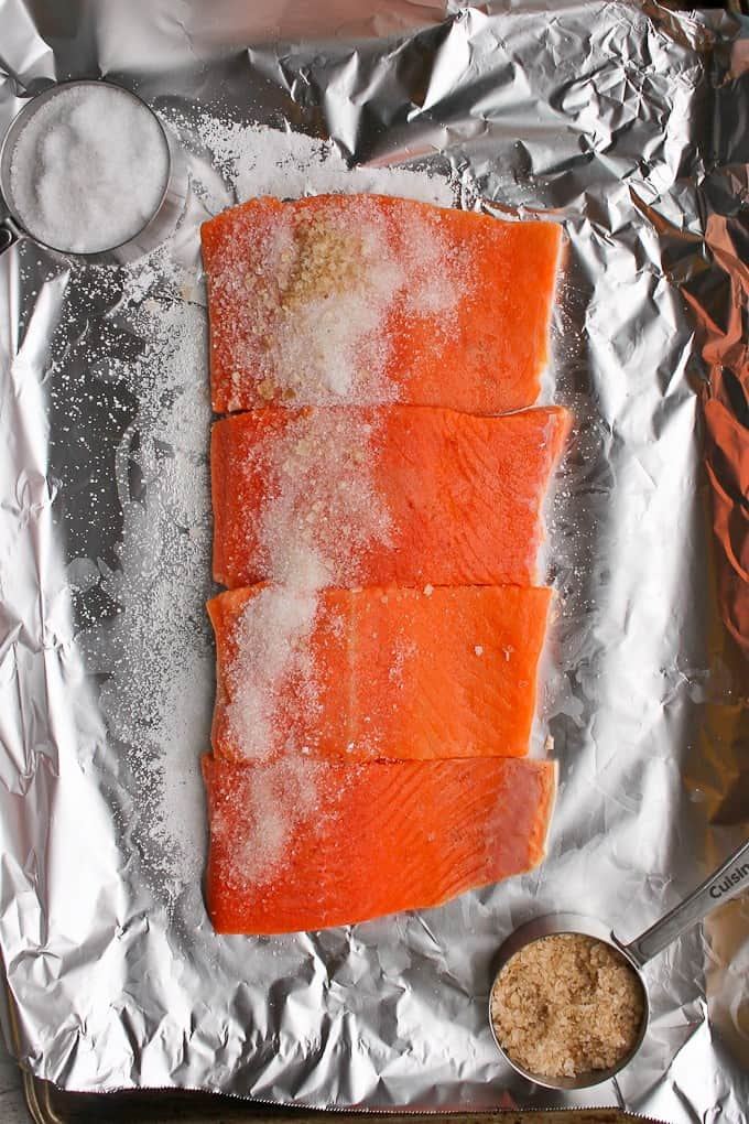 Adding sea salt and smoked salt to the salmon
