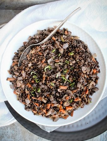 beluga lentil salad in a serving bowl