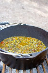 This easy vegan CAMPING Palak Dal (Red Lentils with Spinach) is cooked in a Dutch oven right on the campfire!