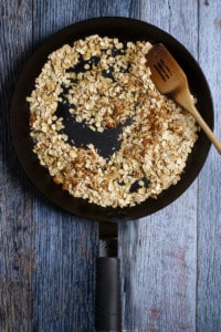 Add Rolled Oats + Chopped Nuts to a Pan