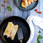 refried bean burritos on a plate
