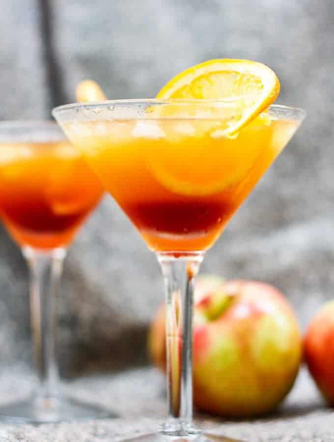 This Apple Cider Kentucky Sunrise is made with bourbon, apple cider, and pomegranate simple syrup. This southern twist on the classic Tequila Sunrise is the perfect fall cocktail.