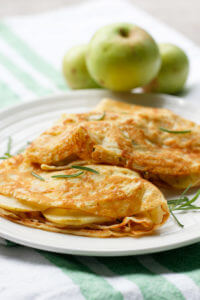 These Rosemary Apple Crêpes are light, delicious, and perfect for lunch. Simply stuff one French Crêpe with apple slices, cheddar cheese, and fresh rosemary, and then lightly grill.