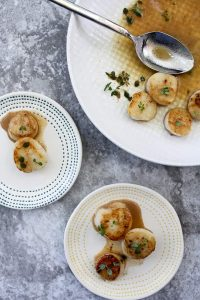 Seared Sea Scallops with wine sauce in a serving dish