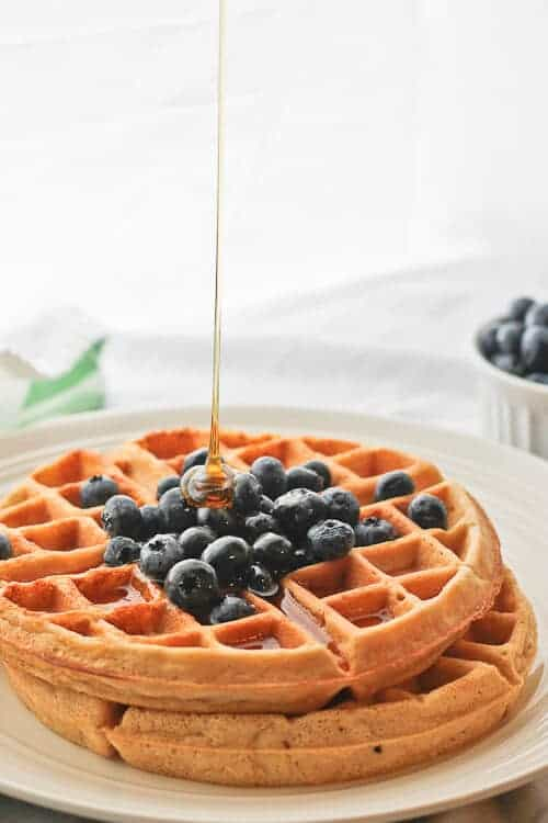 Drizzling Honey onto Dairy-Free Coconut Waffles