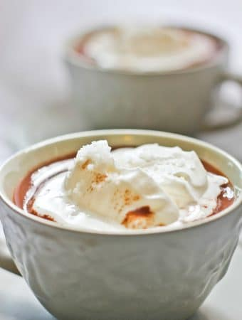 This decadent, vegan-friendly Salted French Hot Chocolate (Chocolat Chaud) is made with crushed chocolate, whole milk and cream (or coconut milk and coconut cream), and topped with flavorful gourmet salt. The salt for this recipe was provided by J.Q. Dickinson Salt-Works.