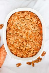 This Kentucky Bourbon Sweet Potato Casserole is made with sweet potatoes mashed with bourbon, maple syrup, and butter, and topped with a bourbon pecan crumble.