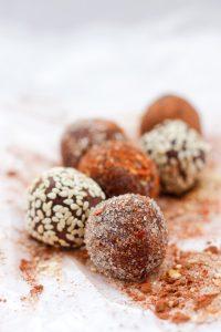 Chocolate truffles with sugar, sesame seed, and chili flake coating
