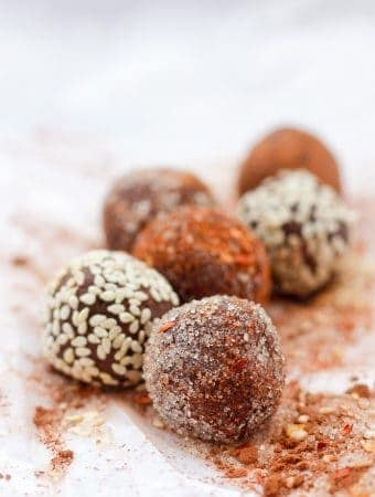 Chocolate truffles with sugar, sesame seed, and chili flake coating
