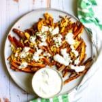 loaded sweet potato fries on a serving platter