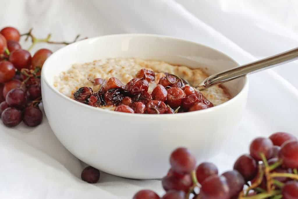 This vegan Roasted Grape Oatmeal is a flavor-packed, sweet and savory breakfast (or brunch) that's ready in 30 minutes.