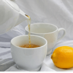This tea hot toddy is made with herbal tea, bourbon, lemon juice, and honey. It's a delicious hot cocktail that's the perfect for sick days.