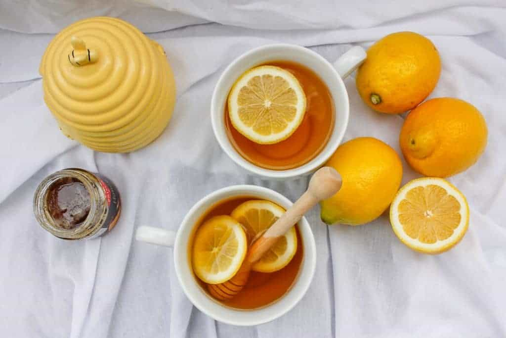 Mint Tea Hot Toddy with Lemons, Honey, and a Honey Pot