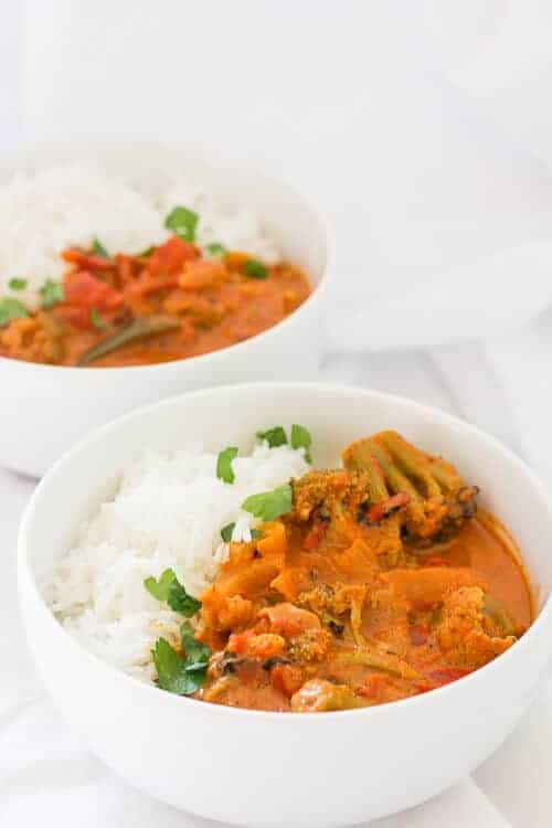 Slow Cooker Vegetarian Curry in bowls with rice.