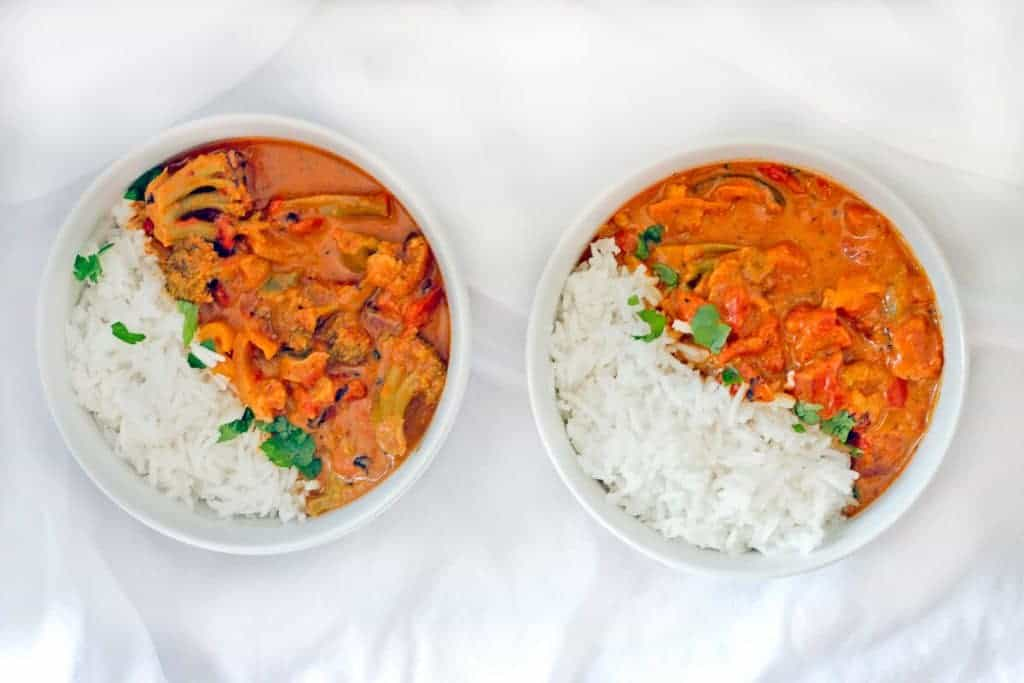 Slow Cooker Vegetable Masala in bowls with rice.