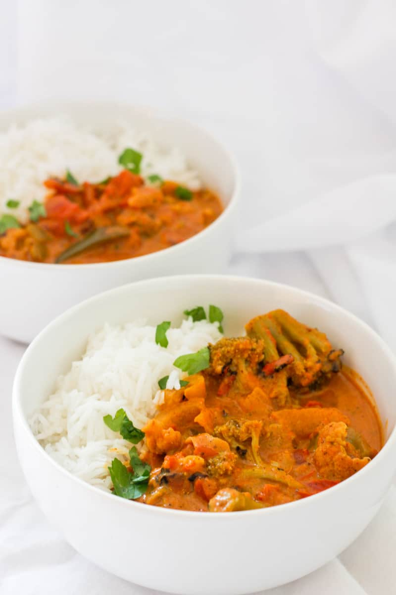 vegetable tikka masala in bowls with rice