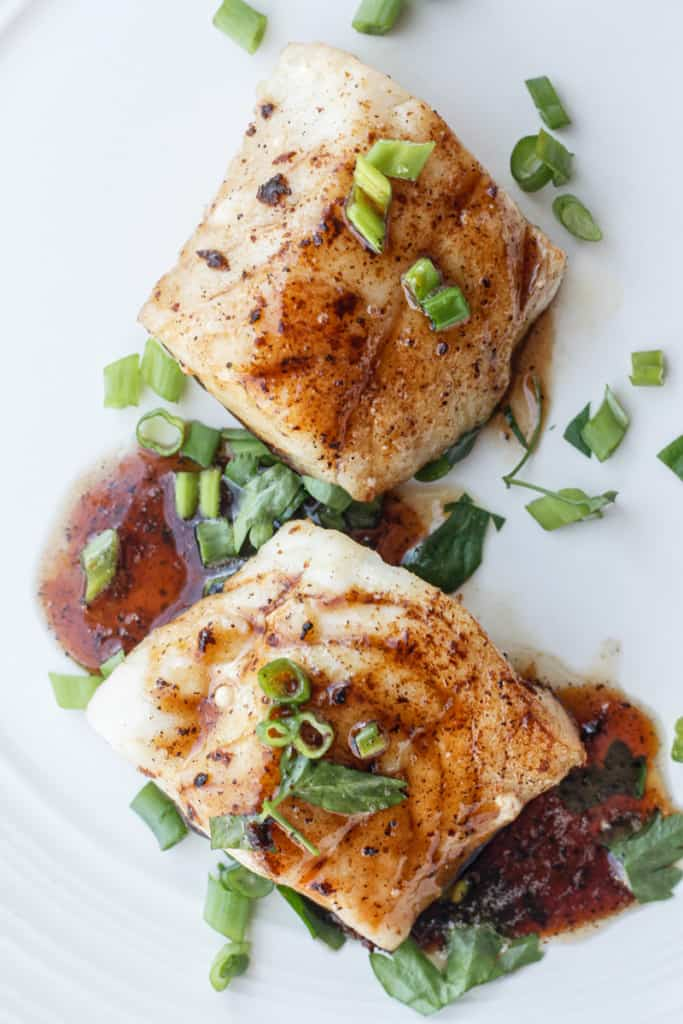 pan-seared cod with bourbon sauce on a plate