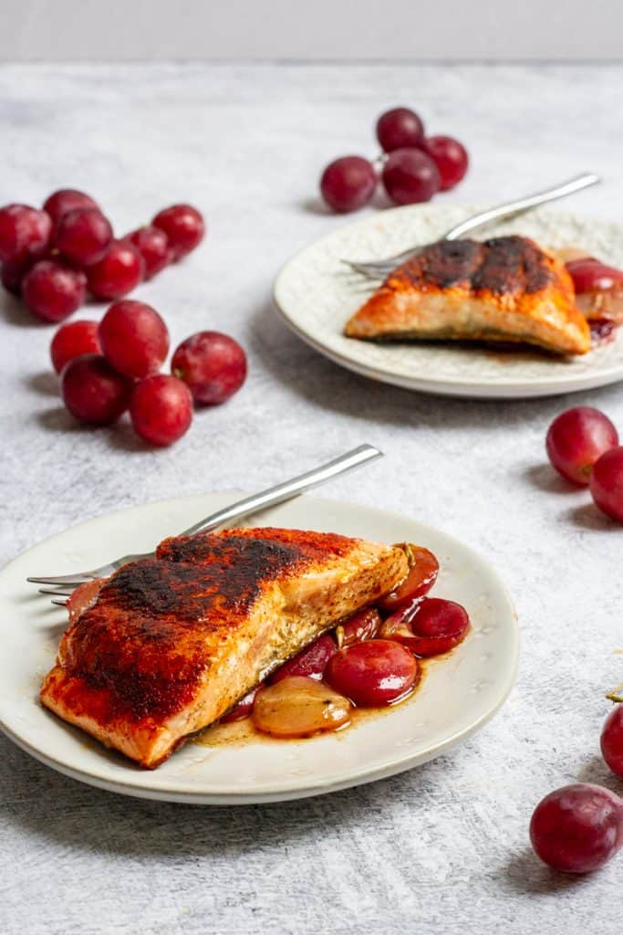 smoked paprika salmon on plates with rosemary grapes