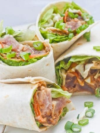 These Sesame Seared Ahi Tuna Burritos are made with delicious, high-quality ahi tuna, filled with crunchy veggies, and drizzled with a ginger soy sauce and a spicy yogurt