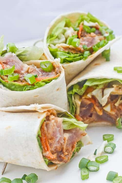 These Wasabi Ahi Tuna Burritos are made with delicious, high-quality ahi tuna, filled with crunchy veggies, and drizzled with a ginger soy sauce and a spicy yogurt